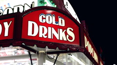 Cold drink sign at carnival stand Stock Footage