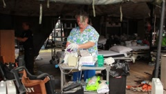 People Working In Medical Shelter  After Tornado (HD) c Stock Footage