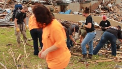 K-9 Unit and Helpers Looking Through Tornado Damage. (HD) m Stock Footage