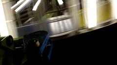 Motor spinning vertical carnival ride at night Stock Footage