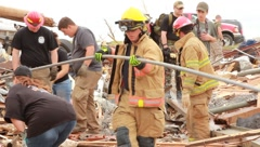 People Start Clean-up With Firemen After Tornado (HD) c - stock footage