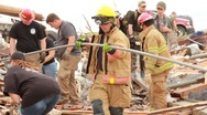 Stock Video Footage of People Start Clean-up With Firemen After Tornado (HD) c