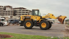 Front Loader Moving Debris From Tornado (HD) c Stock Footage