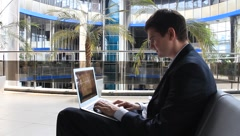 Businessman with personal computer Stock Footage