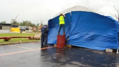 People Set Up Tent and Supplies After Tornado Disaster (HD) c Stock Footage