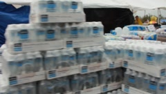 Pan Of Water and Supplies For Tornado Disaster Victims (HD) c Stock Footage