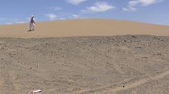 Sand dune woman - stock footage