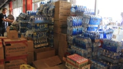 People Give and Take Supplies for Tornado Relief (HD) c Stock Footage