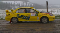 Motorsports, rally car in snow, launch follow, #5 Mitsubishi Ralliart Lancer Stock Footage