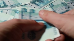 Hand recount many banknote thousand rubles - stock footage