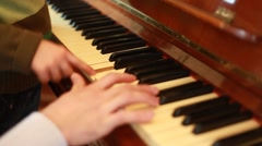 Closeup of hands of father and son playing on piano Stock Footage