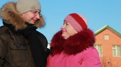 Woman and man at winter outdoors Stock Footage