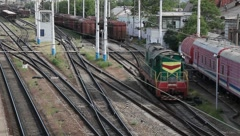 Shunting locomotive at a railway station Stock Footage