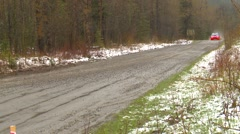 Motorsports, rally car race in snow, #27  Subaru WRX follow shot Stock Footage