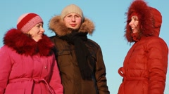 Man and two women standing outdoors at winter Stock Footage