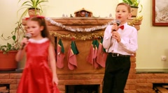 Sister and brother dance and sing song into microphone Stock Footage