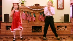 Sister and brother sing song into microphone Stock Footage