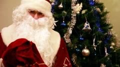 Santa Claus with presents and New Year tree at home Stock Footage