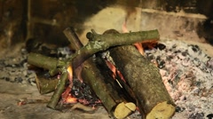 Simple fireplace with fire logs burning out to give heat Stock Footage