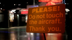 Please Do Not Touch the Aircraft sign at Museum Stock Footage