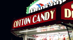 Cotton Candy sign at Night carnival Stock Footage