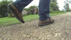 Walkers Legs and Walking Boots Stock Footage