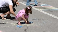 The Small children draw the colour piece of chalk on asphalt Stock Footage