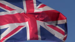 British Flag in the wind with blue sky Stock Footage