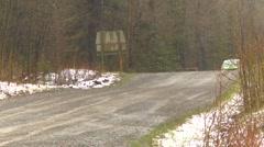 Motorsports, rally car race in snow, #9  Mitsubishi EVO IV follow shot Stock Footage