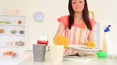 Young brunette tidying the kitchen Stock Footage