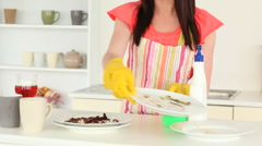 Attractive brunette tidying the kitchen Stock Footage
