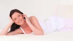 Stock Video Footage of Attractive dark-haired woman talking on the phone