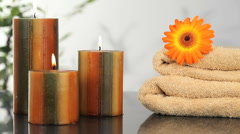 Close-up on candles, towels and sunflower Stock Footage