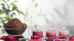 Spa salts near lighted candles Stock Footage