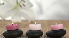 Candles raised on black stones Stock Footage