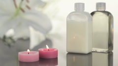 Candles and massage lotion in a Spa centre Stock Footage