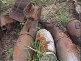 War zone scrap  explosive-bombs leftovers 2 Stock Footage