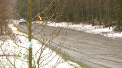 Motorsports, rally car race in snow, #6 white Mitsubishi EVO VI  follow  Stock Footage