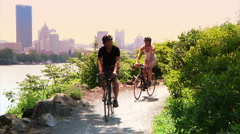 Pittsburgh Bicyclists Ride on Washington's Landing Trail Stock Footage