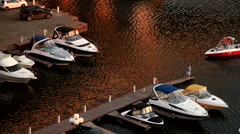 Dock marina with motorboats at dusk Stock Footage