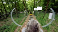 Roller coaster in forest (forward) Stock Footage
