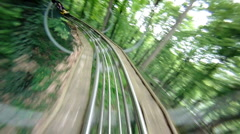 Roller coaster in forest (backward) Stock Footage