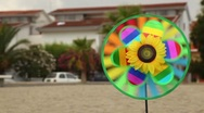 Stock Video Footage of Round toy with sunflower in the center is set in the ground and spinning