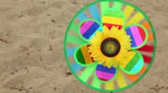 Toy with a sunflower in the center is set in the ground, then the girl took it Stock Footage