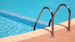 Handrails to stairs leading to swimming pool Stock Footage