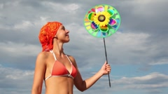 Close-up view of woman holding toy that spins on the background of sky Stock Footage