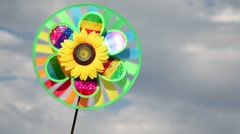 Toy with sunflower in center, that spins on the background of sky Stock Footage