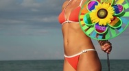 Woman's body with a colored toy, which rotates Stock Footage