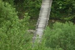 Woody river bridge - stock footage