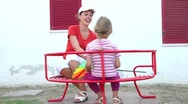 Stock Video Footage of Mom and daughter spinning on the carousel
